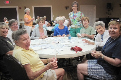 Volunteer wrap cutlery in preparation for the 4th of July Pancake Breakfast at Community Hall.