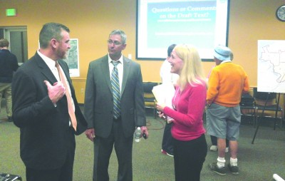 Ruskin's Mariella Smith discusses the new Land Development Code with county attorney Adam Gormley, left, and Joe Moreda, director of the county's planning and zoning division after a public meeting introducing the amendment March 24 at SouthShore Regional Library.  KEVIN BRADY PHOTO