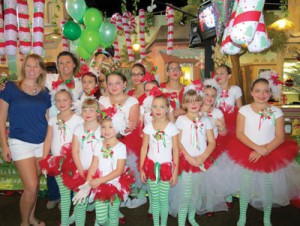 Youngsters help out at the Showmen's Association Christmas charity dinner last December. More than 250 disabled youngsters received presents at the event, one of many such charitable events the Association supports throughout the year. International Independent Showmen's Association photo