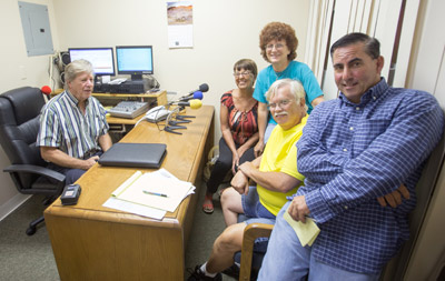 WSCQ FM radio with volunteers Judy Long, Elysa Hendricks, Vern Hendricks and Frank Vetrone. The station currently has 11 volunteers to help in its operation 24-7. At 96.3 FM, the station focuses on Greater Sun City Center. Mitch Traphagen photo.
