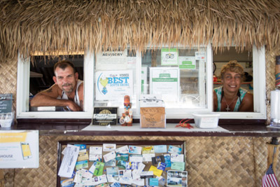 Scott Curtis and Lisa Csiki, owners of The Dog House and More in Ruskin,  at their outdoor restaurant on Shell Point Road. Mitch Traphagen photo
