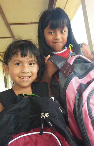 Diana, right, and Anayeli Perez were two of hundreds of children who received new backpacks at Back To School Outreach program at Good Samaritan Mission in Wimauma.