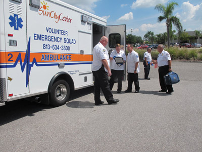 Sun City Center Emergency Squad volunteers gear up last Thursday. From left, Paul O'Connor, Team 8 captain; Cat Rogers, EMR technician; Erik Sager, EMR trainee; Pete Derupo, Team 5 captain; and Tom Murphy, assistant chief of safety. Lia Martin photo.