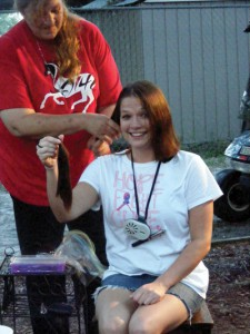 Stefanie Powell gets a short haircut in order to donate her hair and also to benefit Relay for Life in support of her mother, Karen Lewendowski, who is a survivor and has been the keynote motivational speaker at South County's relay for several years.