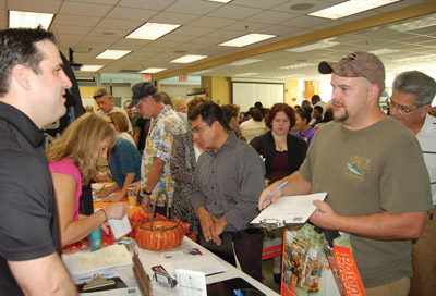 David Ousiany, left, of Elite Staffing Partners, talks with one of hundreds of job seekers.  Chere Simmons photo.