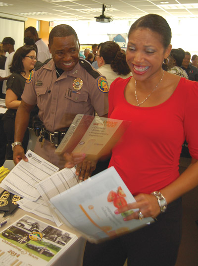 The Florida Highway Patrol was recruiting at the Job Fair also. Above, Trooper Stan Rice and Angela Lyons share a laugh. Rice has been with FHP for seven years and is a Background Investigator for Troop C.The Florida Highway Patrol was recruiting at the Job Fair also. Above, Trooper Stan Rice and Angela Lyons share a laugh. Rice has been with FHP for seven years and is a Background Investigator for Troop C. Chere Simmons photo.