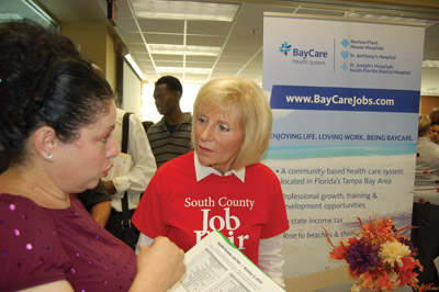 Lizette Ramos talks with Hillsborough County Commissioner Sandy Murman at the recent Job Fair held at Hillsborough Community College's SouthShore Campus. Lizette is currently seeking a nursing position. Chere Simmons photo.