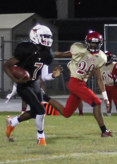 Freshman quarterback Devin Black runs for yardage against Leto