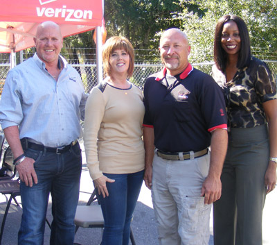 Verizon officials honored local fiber optic technician Troy Hamrick, a veteran of 16 years with the company, who recently came to the aid of Lois and Ed Guerin of Kings Point in Sun City Center before they were taken to Tampa General Hospital by ambulance. Hamrick's quick thinking had him devise a tourniquet out of available materials in his truck. On Oct 27, Verizon officials (from left) Bill Guess, local manager; Jeanmarie Milla, Florida regional president over a 6,000-square-mile area; Hamrick; and Melanie Williams, regional director of operations, were on hand in Ruskin to present Hamrick Verizon's Presidential Heroes Award. Penny Fletcher photo.