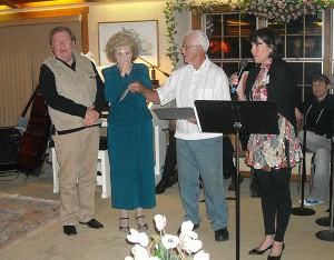Bob Tiberio, second from right, owner of the former Thunderbird Lanes bowling alley and restaurant in Ruskin, celebrated his 85th birthday with a party that was filled with surprises as he donated large sums to charities. Here Bobby and Sherry Burnette, founders of Love a Child Inc., react to the generous donation given to the organization. At right is Jill Kelly of Wells Fargo Advisors. milton brown photo