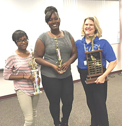 Destiny King, left, who took second place in the Riverview poetry contest, is pictured with Nynchoyha Pitt, center, winner of the Riverview poetry contest and of the High School Poetry Jam, and Riverview High media specialist Jill Driver.