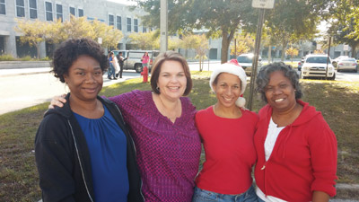 Dr. Ruth Green, left, Michelle Battle, Towanda Edwards and Marilyn Dejesus all pitched in at the event that drew more than 1,000 parents.  Kevin Brady photos.