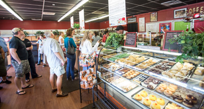 Customers line up to order at Hot Tomato. The establishment is already planning to add new point-of-sale terminals to accommodate the influx of customers. Mitch Traphagen photos.