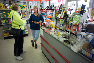 SCC Ace Hardware owner Sue Chapin, right, talks to a customer in her store. Many of her customers told her they appreciated the smaller store and the friendly, personal service.