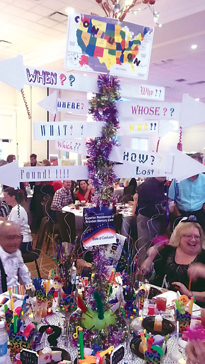 "With each table decorated in the symbols of a state or U.S. territory, the aptly named ""State of Confusion,"" created by Superior Residences of Brandon, took home first place for the best-decorated table."