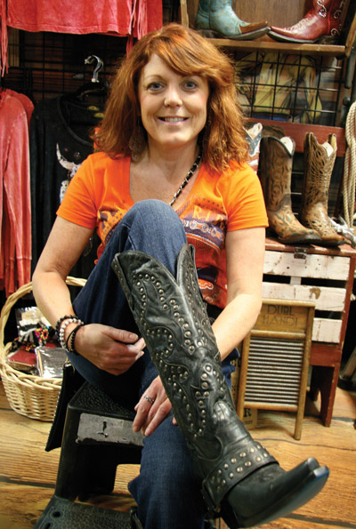 Jami Hanson tries on a pair of boots from Bling Rider. www.BlingRider.com.