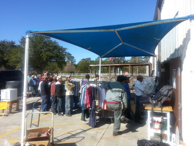 Clients line up at the Beth-El food bank which serves up to 8,000 people a month. Dave Moore photo.
