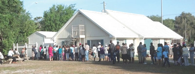 Families line up for food at The Lord's Lighthouse. Kevin Brady photo.