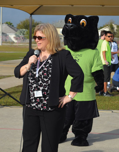 Rebecca Sargable introduces herself to students, staff and parents at Collins Elementary for the first time at a pep rally earlier this month at the school.  Lori Themar photo.