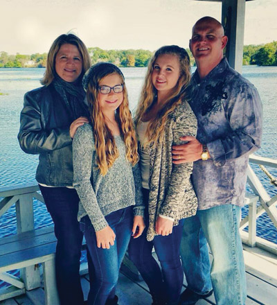Rebecca, Cambree, Kyrstin and Wili Sargable. Wili Sargable is a 1989 graduate of East Bay High School.