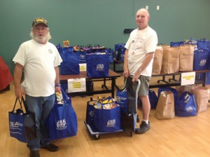 Saint Anne Catholic Church Food Pantry volunteers load up their portion of the donations.