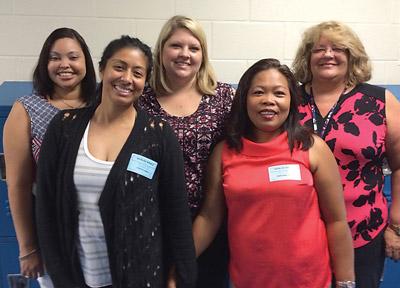 Proud moms and teachers, from left: MaryAnn Jones, Yvette Cabili, Brittney Wilhelm, Sharlyn Aponta and Dawn Simon.