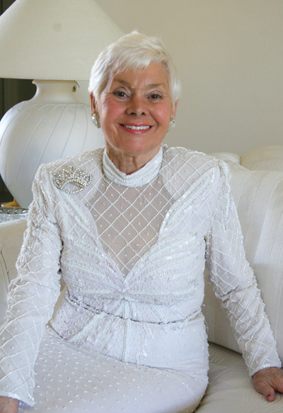 Louise Ferla relaxes in a beaded gown at her home in Valencia Lakes. Lisa Stark photos.