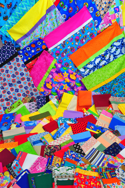 "Colorful pillowcases created for charity by the ASG chapter ""Sewing Sisters."""