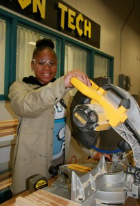 Christine McMillan practices safety principles as she operates the mechanical saw. Lisa Stark photos.