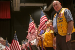 Standing for the fallen: As the names of the community's fallen veterans were read for the 2015 ceremony, family members, friends and honorees stood in honor at each name. Mitch Traphagen photos.