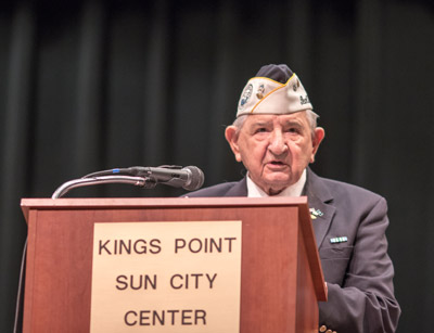 Cmdr. Edward Socha (USN-Ret), reads the names of the fallen during the ceremony. Socha is a Pearl Harbor survivor.
