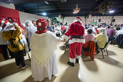 For nearly two decades, many thousands of our community's seniors have found the spirit of love and Christmas during the annual Senior Dinner. This year, your help is needed to make it happen. Mitch Traphagen photos.