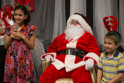 At the Firehouse Cultural Center, where a variety of games and activities took place, Emma, 9, and Xavier, 6, pose with Santa.