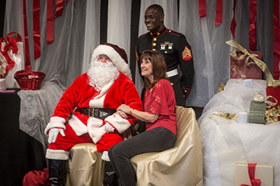 At the Firehouse Cultural Center, Santa poses with Toys for Tots coordinator Ann Hathaway and USMC Sergeant Heywood, also with Toys for Tots. Michelle Traphagen photos.
