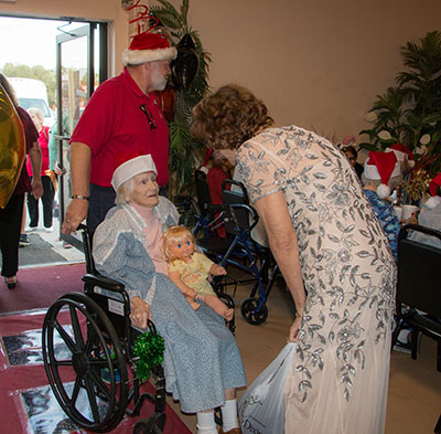 Seniors from nursing homes and memory care units through South Hillsborough were invited to the event. Jones greets a woman from a memory care unit.
