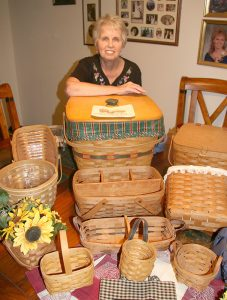 Marge Weber of Sun City Center shows off her collection of Longaberger Baskets, which are all dated and signed by their maker. Her latest addition was a gift she received on March 30th, her birthday. LISA STARK PHOTOS