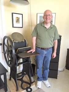 Kurt Carr stands next to his 1894 Golding Pearl printing press in his River Plantation home in Parrish that he bought in December. KURT CARR PHOTOS