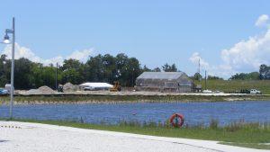 kayaking lake and greenhouse beyond