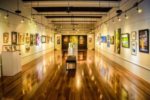 """The center's main gallery branches off from the front lobby. """"Hot! Hot! Hot!"""" was the title and theme of their summer exhibit housed in this section."""