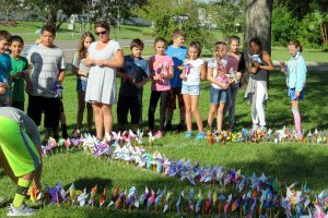 One by one, classes in grades K-5 came out with their teachers onto the school's front lawn to plant their pinwheels to make a huge peace symbol on the lawn at Apollo Beach Elementary School  Sept. 21.