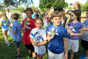 Drew Mihok, left, Sophia Gonzalez and Zane Hardy show off the brightly colored pinwheels they made in Margit Redlawsk's art class to commemorate the International Day of Peace.
