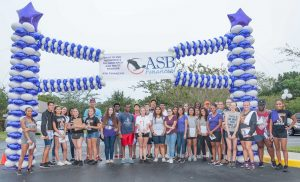 SHARON RABOIN PHOTOS Student volunteers from the East Bay High School and Lennard High School Key Clubs gather for a group photo during the 2016 South Shore Walk to End Alzheimer's Oct. 15.