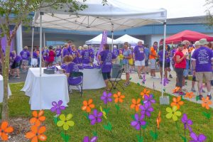 Each color in the South Shore Walk to End Alzheimer's Promise Garden has a distinct meaning: Yellow signifies a caregiver; orange, an advocate; purple, a person currently living with Alzheimer's; and blue, someone whose life was lost to the disease.