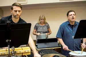 Family members Mark, Carol and John Boccoli play together in the percussion section of the South Shore Symphony Orchestra.