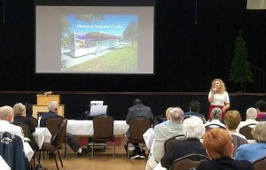 Jessica L. Banko, chief operating officer at the University of South Florida Health Byrd Alzheimer Institute, addresses more than 200 people who turned out for the symposium.