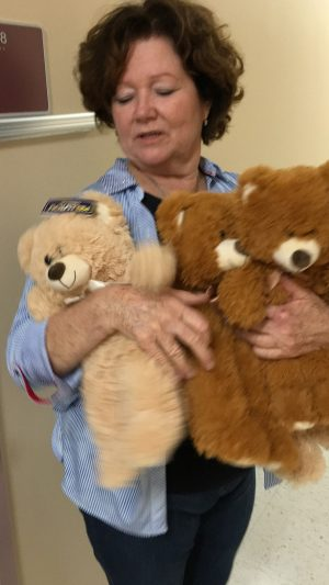 Kim Terrell, Pinecrest Elementary School counselor, clutches one of the teddy bears distributed to Hillsborough County elementary schools.