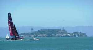 America's Cup contestants in San Francisco Bay with famous Alcatraz Island in the background.
