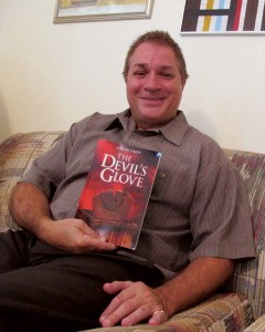 SCC author Cousin Vinny holds The Devil's Glove, his book published by Tate Publishing. Photo Lia Martin