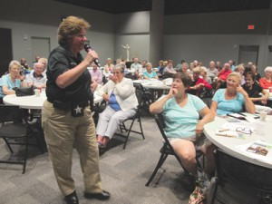 Hillsborough County Sheriff's Office Deputy Jill Woster cautions seniors gathered last week at United Methodist Church for the ID Theft and Scammers seminar in Sun City Center.  Lia Martin Photo