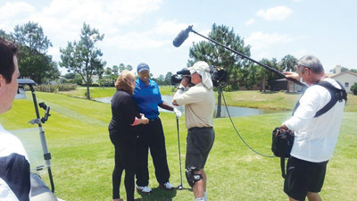 From left, ESPN reporter Shelley Smith interviews Ilee Coleman, who wrote True Confessions of a Golf Addict.  It will be part of a documentary on 'Outside the Lines' to be televised on ESPN at 9 a.m. Sunday morning, July 13.